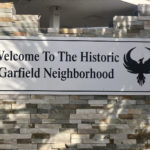 """Welcome To The Historic Garfield Neighborhood"" sign"